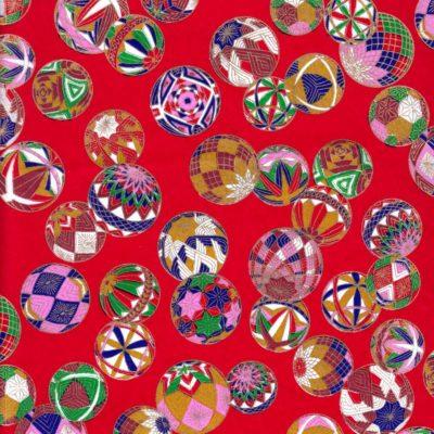 Papier japonais aux boules colorées sur fond rouge