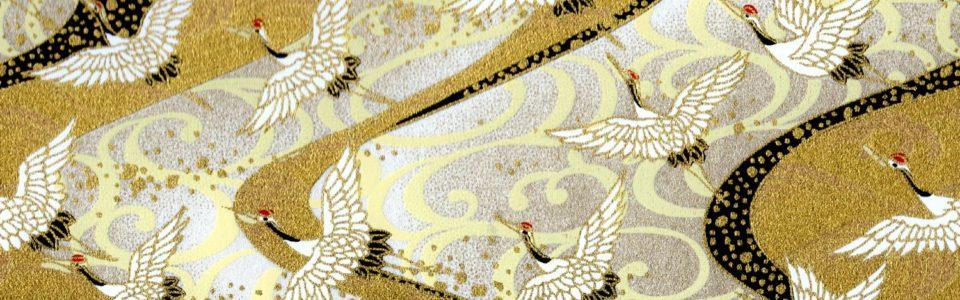 Papier japonais grues blanches sur fond doré